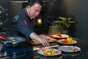 Colorful asian food by professional chef Martin Yan during a cooking show at German exhibition IFA: Shrimps and vegetables