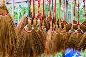 Colorful broomsticks for sale at a local market (Flip 2019)