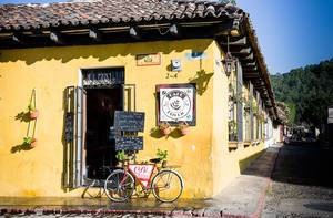 Colorful Coffee Shop at Street Corner with Beautiful Decorations in Antigua, Guatemala