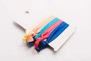 Colorful hair ties on white background