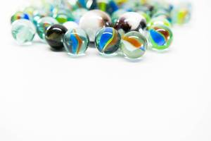Colorful marbles on a white surface (Flip 2019)