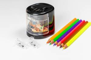 Colorful pencils and electric pencil sharpener on white background (Flip 2020)
