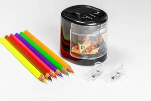 Colorful pencils and electric pencil sharpener on white background
