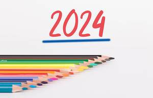 Colorful pencils on white background with text 2024