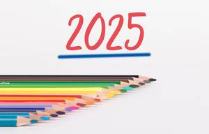 Colorful pencils on white background with text 2025