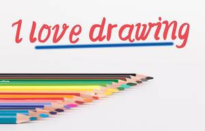 Colorful pencils on white background with text I Love Drawing