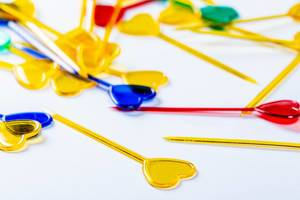 Colorful plastic skewers for food on white background