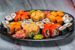 colorful Sushi Set nigiri and sushi rolls for two. Maki, scallop.