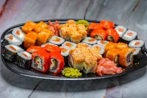 colorful Sushi Set nigiri and sushi rolls for two. Maki, scallop. (Flip 2019)