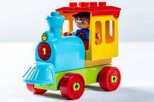 Colorful toy train on white
