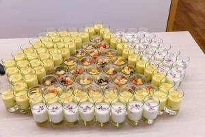 Colourful fruit salad and saffron yoghurt in decorative dessert glasses at a food buffet of the Barcamp OMWest19 by AXA in Cologne, Germany