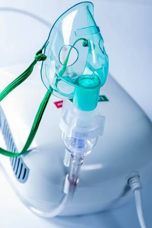 Compressor nebulizer with mask on table