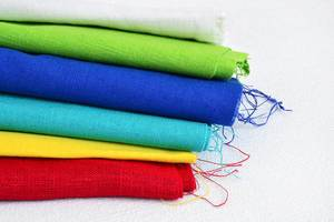 Concept of DIY clothes: stack of fabrics for sewing