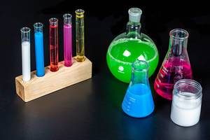 Concept pharmacy and chemistry. Test glass flasks with solutions in research laboratory