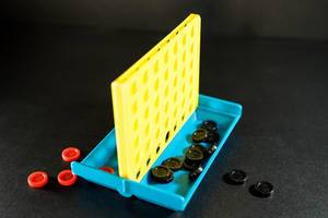 Connect four board game on a black surface