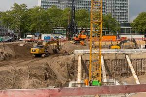 Construction workers with various construction machines at Rudolfplatz in Cologne