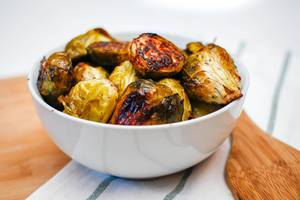 Cooked Brussel Sprouts in a White Bowl