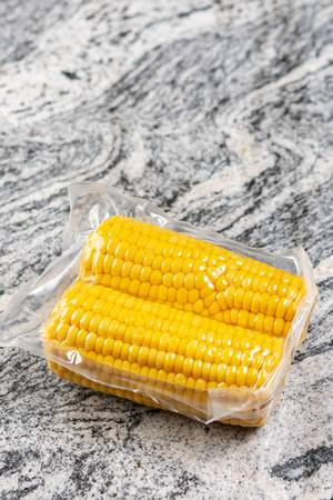 Cooked Young Corn on the grey marble (Flip 2019)