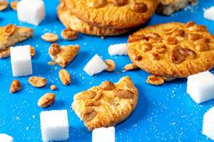 Cookies with peanuts and sugar cubes on a blue background closeup (Flip 2019)