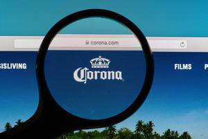 Corona logo under magnifying glass