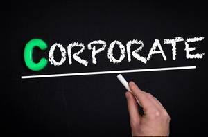 Corporate text on blackboard