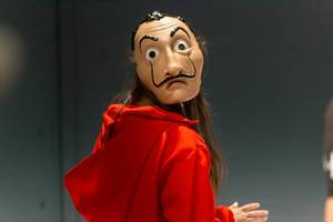 Cosplay at Gamescom: costume depicts a criminal with Salvador Dali mask from the Netflix crime-drama series Money Heist