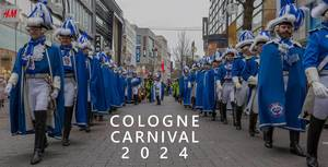 "Costumed men of Kölner Funken Artillerie von 1870 e.V during rose Monday procession, next to picture title ""Cologne Carnival 2024"""