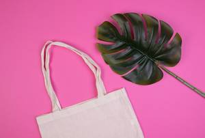 Cotton shopping bag on pink background