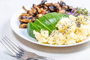 Couscous with Chia seeds, fresh avocado, micro greens and baked mushrooms