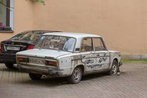 Crappy old Lada alongside a new Mercedes Benz