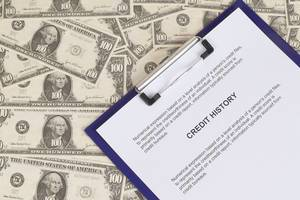 Credit History document with Dollar banknotes
