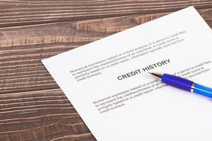 Credit history document with pencil on wooden table