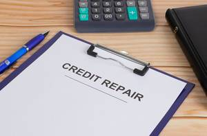 Credit Repair text on clipboard
