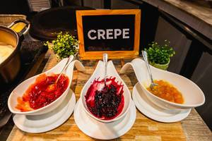 Crepe fillings on wooden table