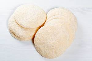 Crispy round rice bread on white background