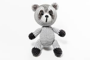 Crochet handmade raccoon toy on a white background (Flip 2019)