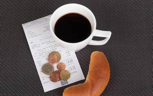 Croissant with coffee and reciept on white background