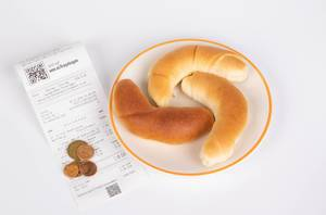 Croissants with reciept and coins