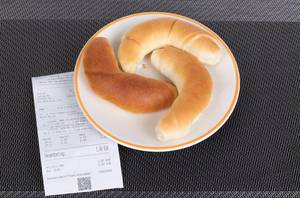 Croissants with reciept on table