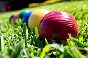 Croquet balls in a line