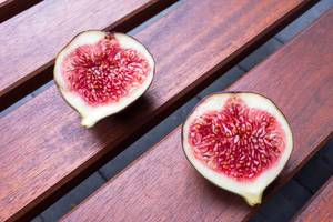Cross section of two figs: fruit pulp and seeds