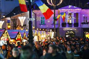 Crowded Christmas market in Sibiu, Romania, night view