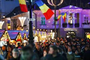 Crowded Christmas market in Sibiu, Romania, night view