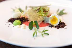 Crudo Nicoise at Chino Latino:  Yellow Fin, Wasabi–Pea Sphere, Black Olive Powder, Quail Egg, Lemon Oil