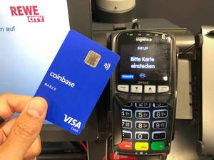 Crypto Visa card Coinbase is used for payment in a german supermarket