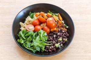 Cuban quinoa bowl: sweet potatoes, cherry tomatoes, rocket and red beans