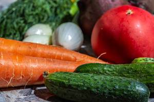 Cucumbers, carrots, onions, tomato and beets - healthy food