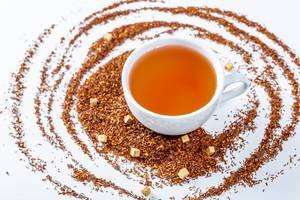 Cup of hot tea with dry tea