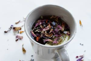 Cup of tea with dry flowers