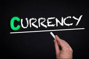 Currency text on blackboard